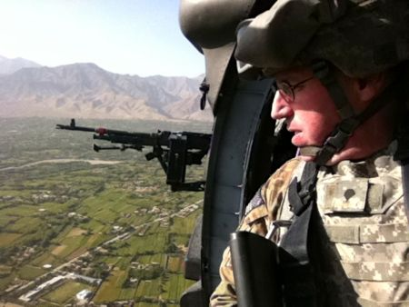 Kotcher flying a helicopter mission in Afghanistan.