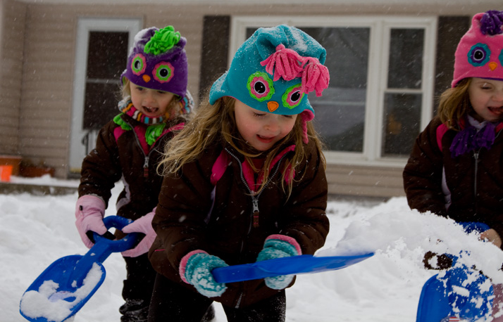 The Winden triplets used matching shovels to help their mom clear the driveway in Prairie Village.