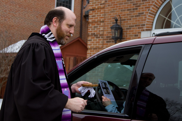 Asbury United Methodist's Jeff Prothro performed an Ash Wednesday service at the church's drive through event.