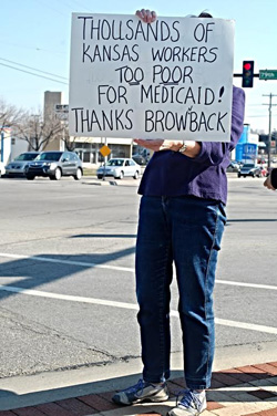Demonstrators in northern Overland Park called for the expansion of Medicaid in Kansas. Photo courtesy Finn Bullers.