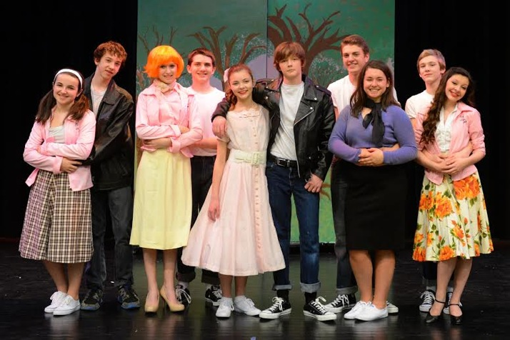 The cast of Grease includes, from left, Tessa Worner (Jan), George Sullivan (Roger), Mia Vaught (Frenchy), Billy Fox (Doody), Savanna Worthington (Sandy), Jackson Bush (Danny), Grace Chisholm (Rizzo),  Harrison Gooley (Kenickie), Harper Mundy (Marty) and Tyler Cunningham (Sonny).