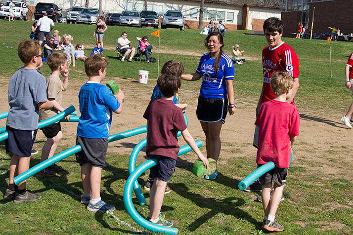 Members of KU's quidditch team taught the younger students the game's fundamentals.