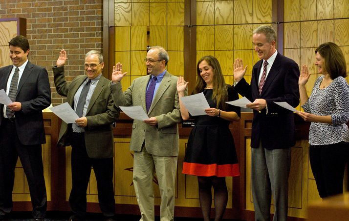 Prairie Village City Councilors (from left) Eric Mikkelson, Steve Noll, Terrence Gallagher, Jori Nelson, Dan Runion and Laura Wassmer were sworn-in at the start of Monday's council meeting.
