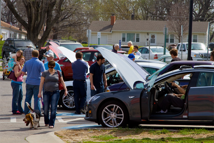The parking lot had several low-emission and electric cars — including the Tesla in the foreground — on display.