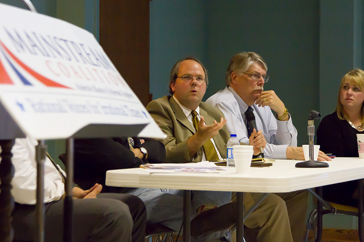 Michael Smith, Associate Professor of Political Science, Emporia State University (left), Mark Peterson, Chair/Professor Political Science, Washburn University, and Holly Weatherford, Advocacy Director, ACLU of Kansas, at the MainStream Coalition's panel Thursday.