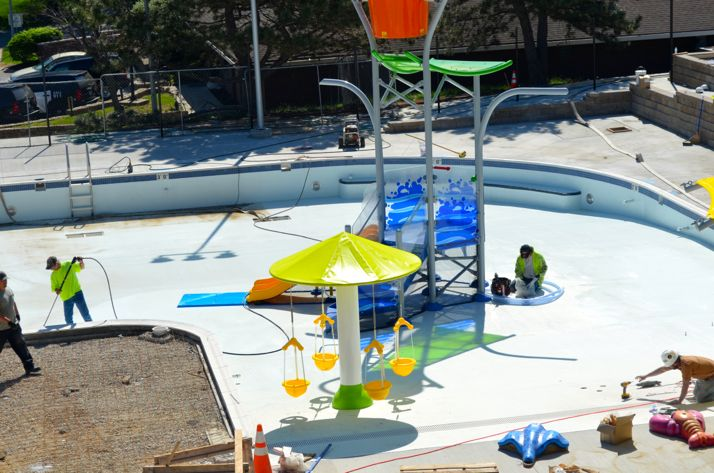 Work continues at a fast pace on the aquatic center in this view from the top of the slide.