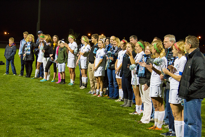 SM East soccer seniors gathered with their families on the field after the conclusion of the game Thursday.