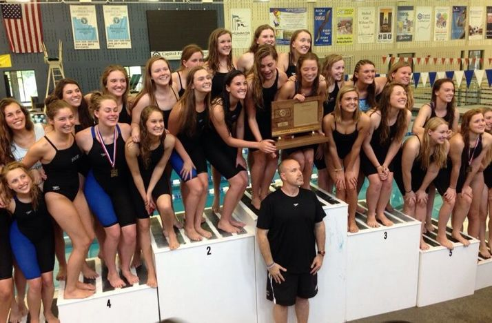 SM East's girls swim and dive team celebrated the school's fifth consecutive state 6A championship. The Lancers are the only team to have held the 6A title. Photo via SM East Athletics Twitter.