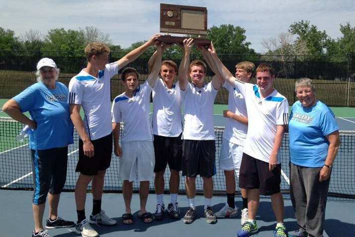 SM East's tennis team hoists its third consecutive state 6A tennis trophy. Photo via SM East Athletics Twitter.