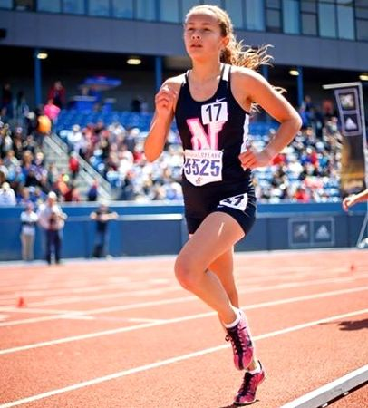 Sada Kernoodle setting the school record in the women's 3200. Photo by Goldia Kiteck.