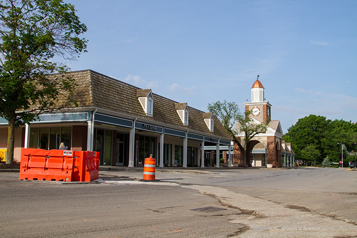 Crews will install asphalt patches around some of the current hazards created by milling work to make them easier for pedestrians to navigate at this weekend's Village Art Show.
