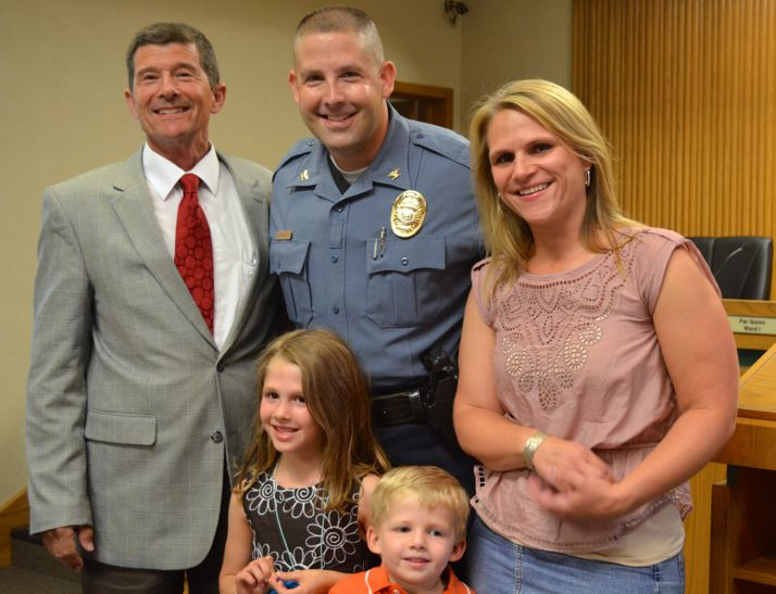 Mayor Steve Schowengerdt with new Mission Police Chief Ben Hadley. Hadley's wife, Sarah, and children, Emma and Theo, joined the new chief after he took the oath of office.