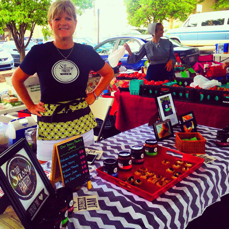 Kay Findlay mans the Our Sassy Pantry table at the Overland Park Farmers Market.