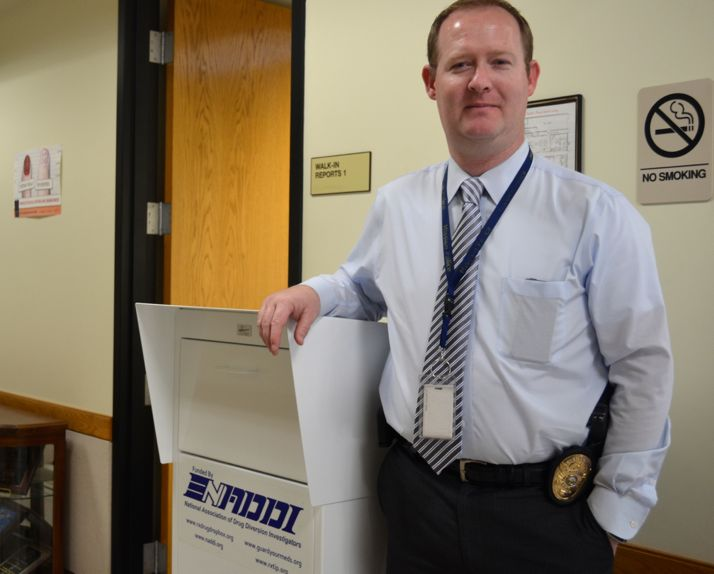 Detective Lt. Dan Madden of the Mission Police Department and the drug take back bin in the lobby of the police department.