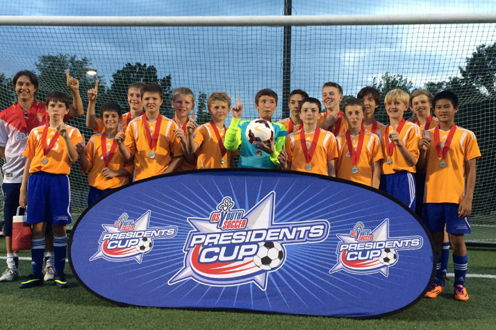 U-13 OPSC-Monaco celebrating their regional win. Photo courtesy Courtney Mitchell.