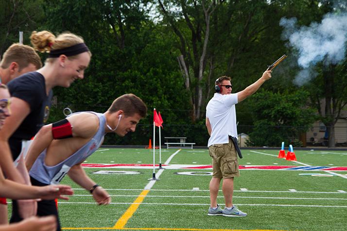 U.S. Olympic Track Team coach Tim Weaver did the honors of firing the starting gun.