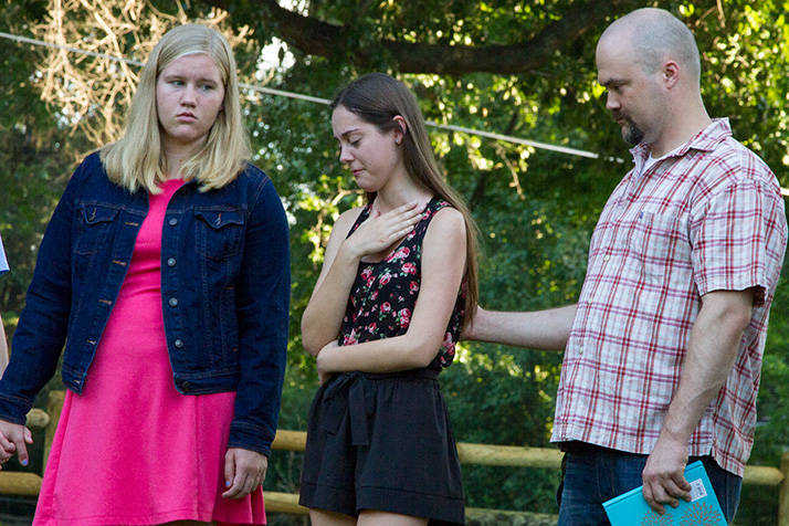Mark Harken's girlfriend Jennifer Noble spoke through tears at the vigil.