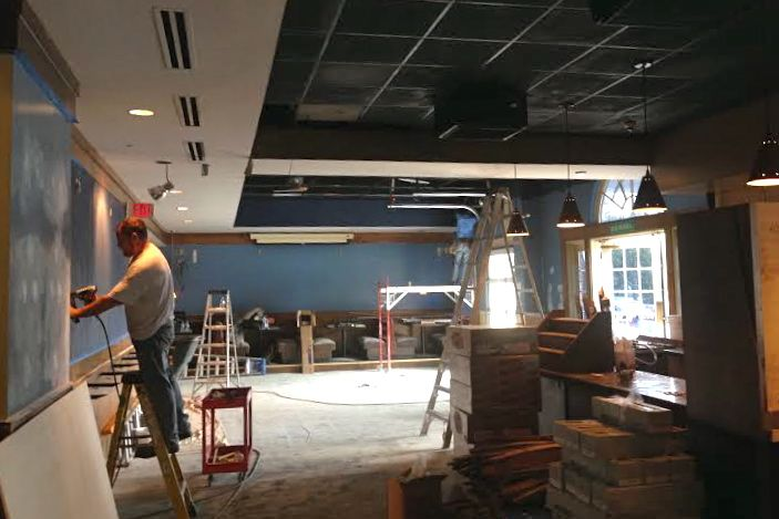 Construction crews work on renovations to the bar area of the Blue Moose Bar & Grill in Prairie Village.
