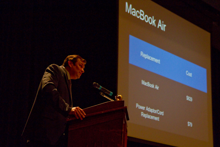 Principal John McKinney has delivered a brief presentation on the computers before students and parents pick them up.