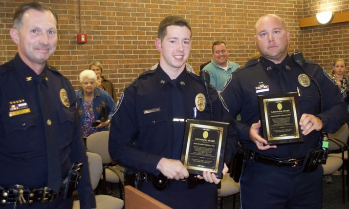 Prairie Village Police Chief Wes Jordan (L-R)) presented the department's Lifesaving Award to officers John Shipman and Joel Colletti.