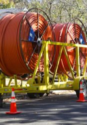 Google Fiber is currently working in Westwood to replace some conduit that was placed under private property in a few spots.