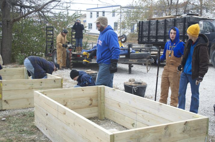 The scouts worked in the Saturday morning cold to build the raised beds.