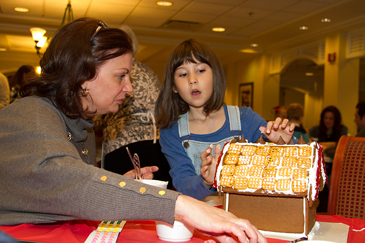 Carrie Fraker helped granddaughter Keegan Barton adorn her house with a roof of pretzels.