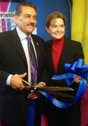 Jose and Tina Ramirez cut the ribbon to open the Moss Printing location in Merriam late last year.