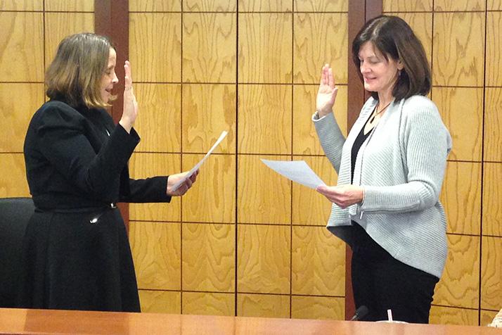 Laura Wassmer took the oath of office from City Clerk Joyce Hagen Mundy on Monday.