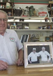 Hersh Casey in his Sinclair station. The picture shows him and brother Ray on their 50th anniversary in business on Johnson Drive.