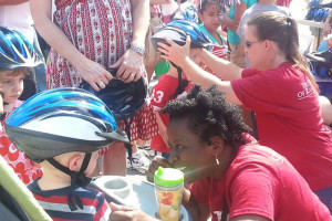 Headstrong for Jake distributed bike helmets at VillageFest for 10 years starting in 2006.