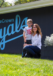 Helen Young and son Fritz Adams, 6, outside their Nall Avenue home featuring the Royals logo.