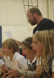 Matt Rapport of Heart of American Shakespeare runs young actors through their lines at St. Ann school.