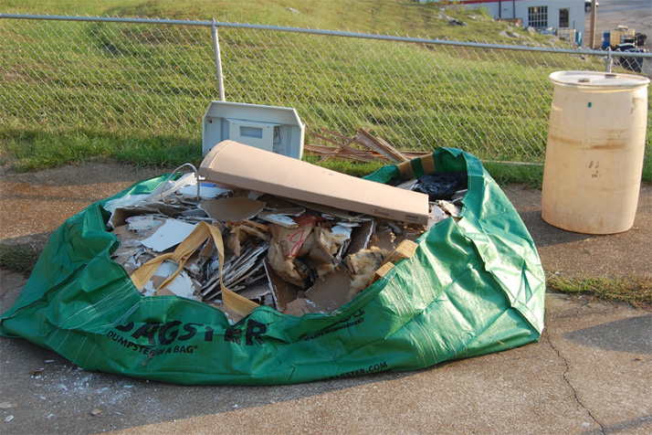 Trash can be visible in a dumpster bag such as this one in Roeland Park.