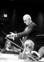 Jonathan Lane conducting the SM East Orchestra. Photo via SM East Orchestra Boosters website.