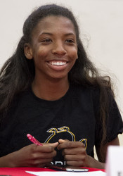 Jazmin Williams singing her commitment letter to Emporia State last spring.