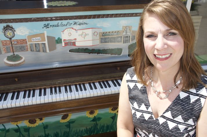Artist Amy Akin painted the piano that will be in front of Brothers Music on Johnson Drive this summer.