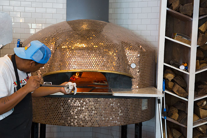 1889 pizzas are baked for 90 seconds in a wood-burning oven imported from Italy.
