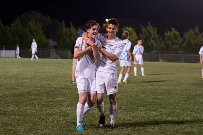 Seniors Luke Ramey and Oliver Bihuniak celebrate after the Lancers' 3-1 win over Olathe North on Tuesday. (Contributed by David Morantz)