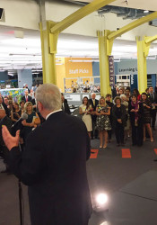 Fred and Carol Logan addressed the crowd at the Johnson County Library Foundation's Library Lets Loose party on Saturday. Photo via Susan Mong on Twitter.
