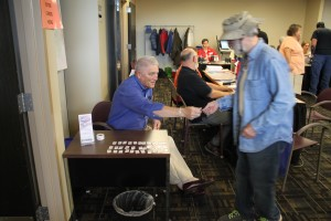 Poll worker Bob Tice was handing out voter stickers to advance voters ahead of the November elections.