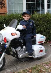 Officer Oliver Davis outside his home in Overland Park.