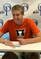 Shawnee Mission East senior Andy Brown signs his ceremonial letter of intent to play tennis at Illinois.