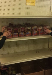 Sharon Ihde (left) and Judie Thomas stock the shelves  at the Village Food Pantry. Photo by Kate Kovarik.