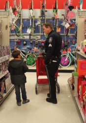 Sgt. Eric McCullough patiently listened to his seven-year-old shopper.