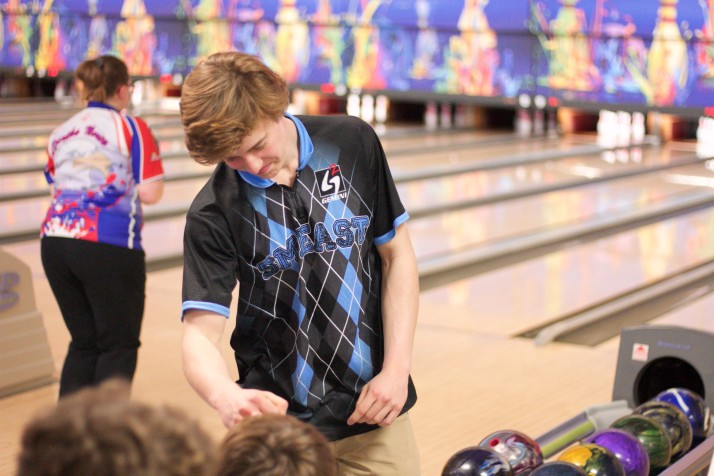 Shawnee Mission's Ian Estes receives a fist bump from Chase Tetrick after Estes rolled a strike.