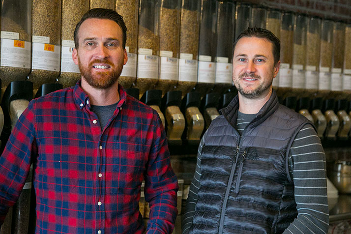 Clay Johnson (left) and Kevin Combs, two of Brew Labs' four owners, in the company's current space, which is closing Friday.