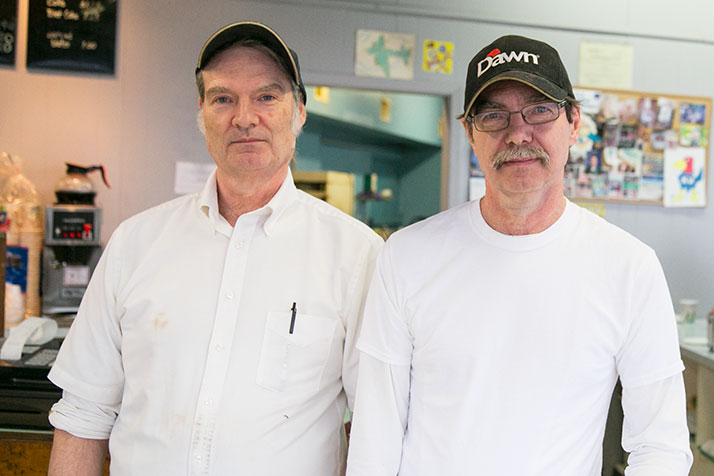 Brothers John (left) and Rodney still work in the shop founded by their parents in the late 1960s.