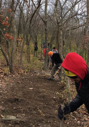 Urban Trail Co. crews at work on the Blue-Swope connector trail in 2014. Photo via Facebook.