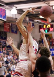 Bishop Miege's Francesco Badocchi flips a pass behind his head to Jeremiah Robinson-Earl.